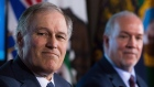 Washington State Gov. Jay Inslee, left, and British Columbia Premier John Horgan