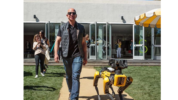 Here's Jeff Bezos taking a robot dog for a walk