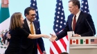 Canadian Foreign Minister Freeland shakes hands with U.S. Trade Representative Lighthizer as Mexican Economy Minister Guajardo looks on during a joint news conference on the closing of the seventh round of NAFTA talks in Mexico City