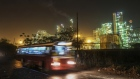 A bus passes a Bharat Petroleum Corp. refinery illuminated at night in the Mahul area of Mumbai