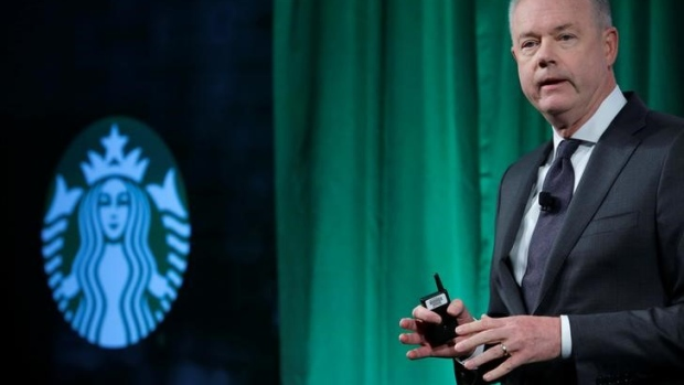 FILE PHOTO - Kevin Johnson delivers remarks at the Starbucks 2016 Investor Day in Manhattan, New York
