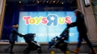 FILE PHOTO -  People pass by Toys R Us store at Times Square in New York