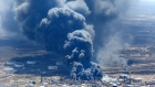 Dark smoke rises from Husky Energy oil refinery following an explosion in Superior, Wisconsin, U.S.,