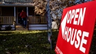 "An ""Open House"" sign is displayed as potential home buyers arrive at a property for sale in Columbus, Ohio, U.S., on Sunday, Dec. 3, 2017."