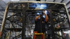An employee welds the frame of an electric vehicle at the BYD Coach and Bus factory in Lancaster, California, U.S., on Thursday, Oct. 5, 2017. BYD unveiled the newly expanded 450,000 square foot factory on Friday, North America's largest electric bus manufacturing facility.