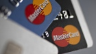 Mastercard Inc. credit cards are arranged for a photograph in Washington, D.C., U.S., on Monday, Oct. 24, 2016.