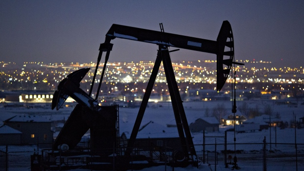 A pumpjack operates above an oil well at night in the Bakken Formation in North Dakota