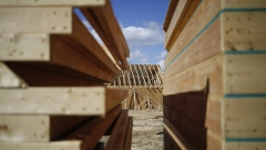 Stacks of wood sit in front of a home under construction in the Toll Brothers Inc. Regency at Palisades community in Charlotte, North Carolina, U.S., on Friday, Feb. 24, 2017. The U.S. Census Bureau released construction spending figures on March 1.