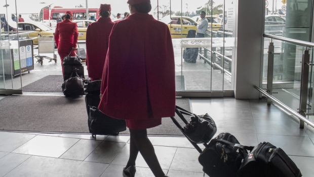 Avianca Holdings SA flight attendants exit El Dorado International Airport (BOG) in Bogota, Colombia, on Tuesday, Oct. 31, 2017. Avianca Holdings SA reported a net income of $36.1 million USD in the third quarter despite a pilot strike that lasted for almost two months.