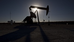 The silhouette of an oil pump jack is seen in Texas, U.S.