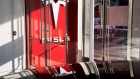Signage is displayed at the entrance to the new Tesla Inc. showroom in New York.