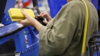 A customer uses a credit card terminal to complete a purchase at a Wal-Mart Stores Inc. location in Burbank, California, U.S., on Thursday, Nov. 16, 2017. Black Friday, the day after Thanksgiving, marks the traditional start to the U.S. holiday shopping season.