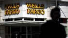A pedestrian passes in front of a Wells Fargo & Co. bank branch in New York, U.S., on Tuesday, Jan. 9, 2018. Wells Fargo & Co. is scheduled to release earnings figures on January 12.