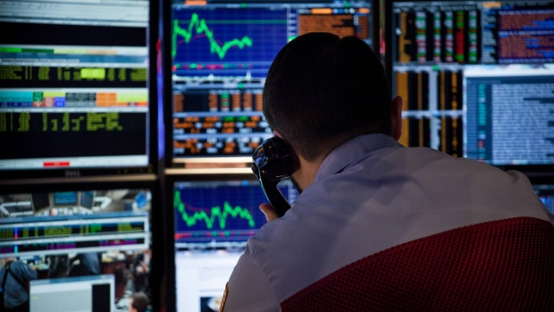 A trader works on the floor of the New York Stock Exchange (NYSE) in New York, U.S., on Monday, Dec. 19, 2016. A cautious tone spread through financial markets as the last full trading week in 2016 began.