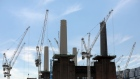 Cranes stand above the Battersea Power Station office, retail and residential development, in London. Photographer: Chris Ratcliffe/Bloomberg