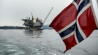 A Norwegian national flag flies from the back of a boat in view of the the Aasta Hansteen gas platform operated by Statoil ASA during its ceremonial baptism near Stord, Norway, on Thursday, March 8, 2018. Oil companies operating in Norway raised investment forecasts for this year after a wave of projects were approved, and expect spending to rise for the first time since crude prices collapsed in 2014.