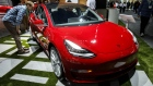 The Tesla Inc. Model 3 vehicle is displayed during AutoMobility LA ahead of the Los Angeles Auto Show in Los Angeles, California, U.S., on Wednesday, Nov. 29, 2017. AutoMobility LA brings automakers, tech companies, designers, developers, startups, investors, dealers, government officials and analysts together to unveil the future of transportation with over 50 vehicle debuts.