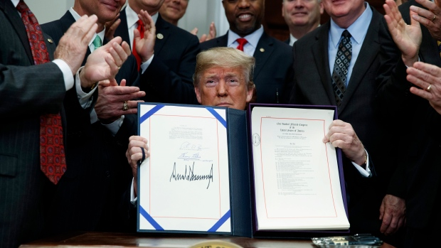 Trump signs law rolling back banking rules, an effort led by Idaho's Sen. Crapo