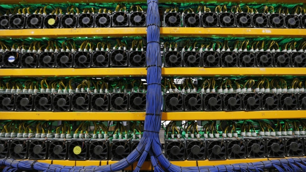 Mining machines stand at the Bitfarms cryptocurrency farming facility in Farnham, Quebec, Canada, on Wednesday, Jan. 24, 2018. Bitfarms says it's making more than $250,000 a day from minting Bitcoin, other virtual currencies and fees at four sites in the province.