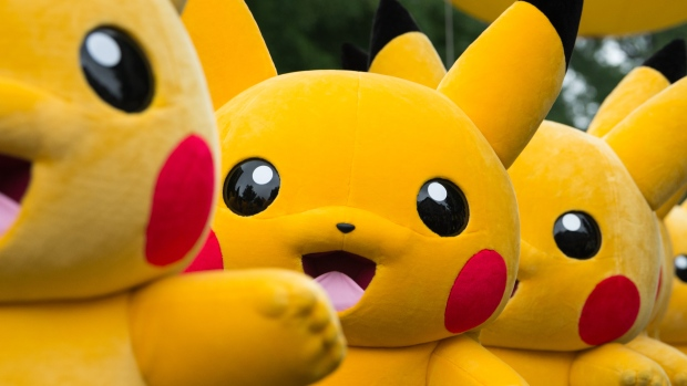 Performers dressed as the Pikachu character from Nintendo Co.'s Pokemon franchise march during the Pikachu Carnival Parade organised by Pokemon Co. in Yokohama, Japan, on Monday, Aug. 14, 2017. About 60 million people still play the Pokemon Go mobile game each month, according to data from mobile app research firm Apptopia, and one in five of those players opens the game on a daily basis.