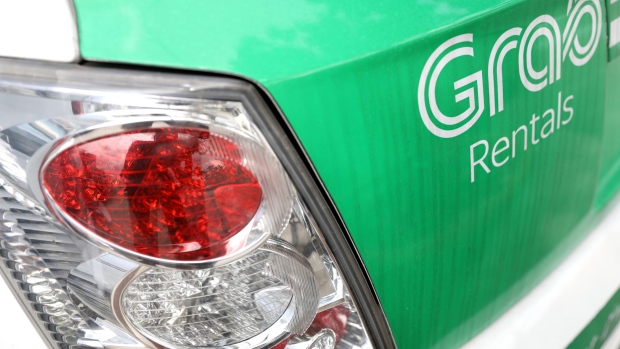 Toyota to Buy $1 Billion Grab Stake to Expand in Ride Hailing - BNN
