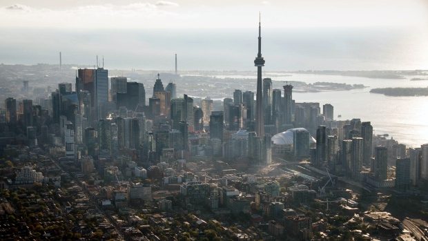 The CN Tower stands among buildings in the downtown skyline in this aerial photograph taken above Toronto, Ontario, Canada, on Monday, Oct. 2, 2017.
