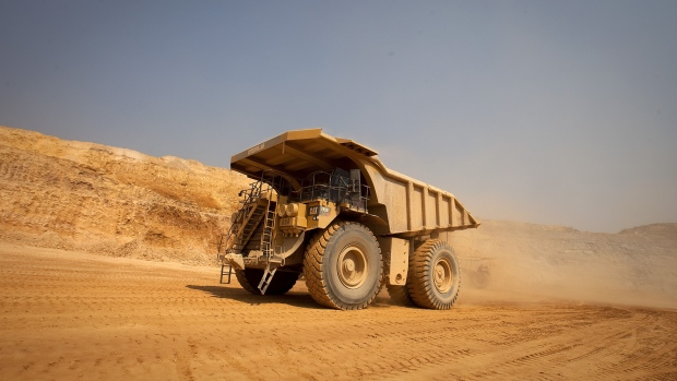 A Caterpillar Inc. mining truck leaves for the processing plant after collecting newly-excavated ore from the open pit at Katanga Mining Ltd.\'s KOV copper and cobalt mine in Kolwezi, Katanga province, Democratic Republic of Congo, on Wednesday, Aug. 1, 2012. Israeli billionaire Dan Gertler, whose grandfather co-founded Israel\'s diamond exchange in 1947, arrived in Congo in 1997 seeking rough diamonds. Since those early days, Gertler has invested in iron ore, gold, cobalt and copper as well as agriculture, oil and banking.