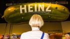 An attendee visits Kraft Heinz Co. booth during a shareholders shopping day ahead of the Berkshire Hathaway annual meeting in Omaha, Nebraska, U.S., on Friday, May 4, 2018. Berkshire Hathaway Inc. investors should get ready for a bumpy ride. Warren Buffett's company is scheduled to report earnings Saturday morning before its annual meeting, and a new accounting rule could sink results.