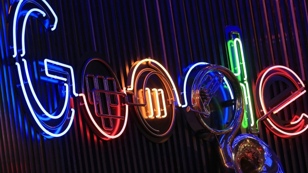 The Google Inc. logo hangs illuminated at the company's exhibition stand at the Dmexco digital marketing conference in Cologne, Germany.