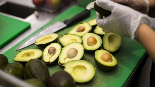 A worker prepares avocados inside a Sweetgreen Inc. restaurant in Boston, Massachusetts