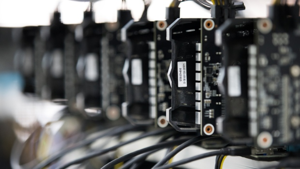 Circuit boards sit on shelves at a cryptocurrency mining facility in Incheon, South Korea, on Friday, Dec. 15, 2017. Hedge funds are pulling out of gold bets as more exciting moves in equities and cryptocurrencies make safe-haven investments look boring.