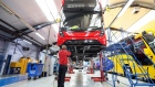 An employee works beneath the drivers cab of an Enviro 400 London bus at the Alexander Dennis Ltd. factory in Scarborough, U.K., on Wednesday, Sept. 13, 2017. Manufacturing in the U.K. rose in July for the first time this year, boosted by a strong rebound in car production. Vehicle output, which had fallen sharply in recent months, surged almost 14 percent, the most since March 2009, helped by new models rolling off production lines.