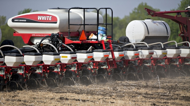 A farmer adjusts a AGCO Corp. White planter machine. Photographer: Daniel Acker/Bloomberg