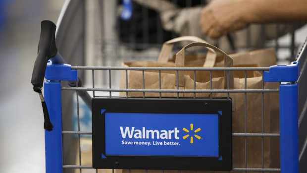 The Wal-Mart Stores Inc. logo is displayed on a shopping cart inside the company's location in Burbank, California, U.S., on Tuesday, Nov. 22, 2016.