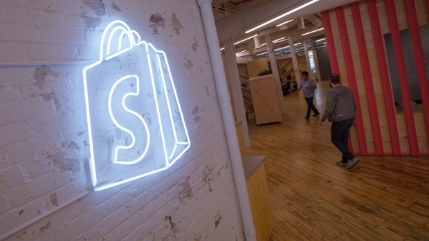 The logo of Shopify Inc. hangs on a wall at the company's office in Toronto, Ontario, March 13, 2015