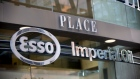 Esso and Imperial Oil signage is displayed on Fifth Avenue place in Calgary, Alberta, Aug. 14, 2013