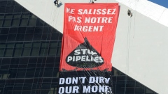 Greenpeace activists hang a banner from Olympic Stadium in Montreal