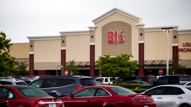 Vehicles sit parked outside a BJ's Wholesale Club Holdings Inc. location in Miami, Florida, May 2018