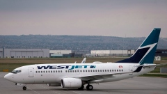 WestJet planes are seen at the Calgary Airport in Calgary, Alta., Thursday, May 10, 2018.