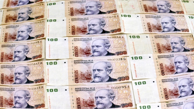 Argentina spikes key interest rate as its currency plunges