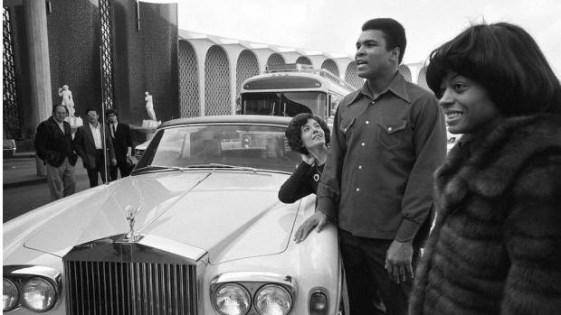 Muhammad Ali poses with his Rolls Royce
