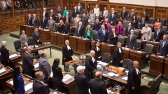 Ontario MPPs sing the national anthem as the Ontario Legislature