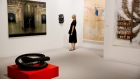 A visitor looks at various art installations on display during Art Basel Miami Beach in Miami, Flori