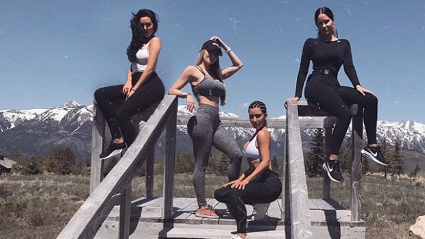 Kim Kardashian (far left) sports athleisure wear in an Instagram post from June 1, 2018