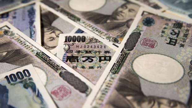 Japanese 10,000 and 1,000 yen banknotes are arranged for a photograph in Tokyo, Japan, on Tuesday, Sept. 5, 2017. Japanese stocks fell as the yen strengthened while investors prepared themselves for the economic damage that Hurricane Irma may inflict on Florida and mulled U.S. President Donald Trump's most recent comments on North Korea.