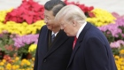 U.S. President Donald Trump, right, speaks with Xi Jinping, China's president, during a welcome ceremony outside the Great Hall of the People in Beijing, China. Photographer: Qilai Shen/Bloomberg