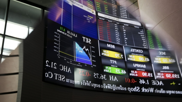48d2a9717335 An electronic stock board is reflected on a surface at the Stock Exchange of  Thailand (