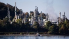 A boat sails past a refinery in Burnaby, British Columbia, Canada.
