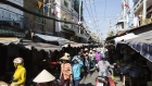 Shoppers walk through a street market in Ho Chi Minh City, Vietnam on Friday, Jan. 12, 2018. A global trade recovery and Vietnam's young and low-cost workforce have been magnets for international investors like Nestle SA, which have opened factories in the country this year. That's helping underpin its economy, which expanded 6.8 percent in 2017, among the fastest in the world.