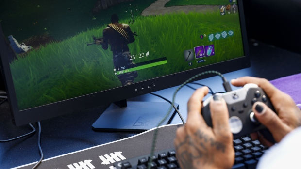 An attendee plays in the Epic Games Inc. Fortnite: Battle Royale Celebrity Pro Am on the sidelines of the E3 Electronic Entertainment Expo in Los Angeles, California, U.S., in Los Angeles, California, U.S., on Tuesday, June 12, 2018.
